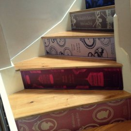 http://fancy.com/things/313511685782505865/Classic-Book-Stair-Decals