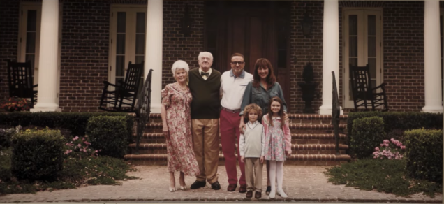 A white family posing for a photo in front of a large house from the film Get Out.